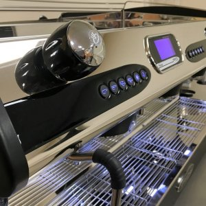 Fracino P.I.D espresso machine 3 group, close up side view, chrome and black