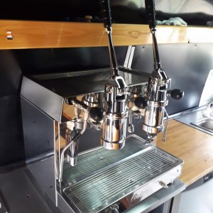Fracino retro espresso machine with levers in situ, side view, chrome