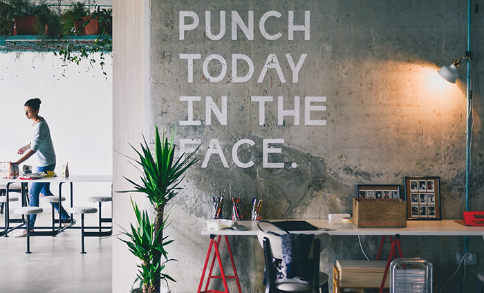 Punch Today In The Face written on the wall