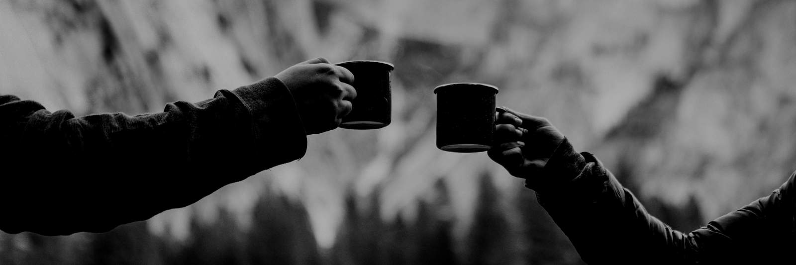 Two People Toasting with Cups of Coffee