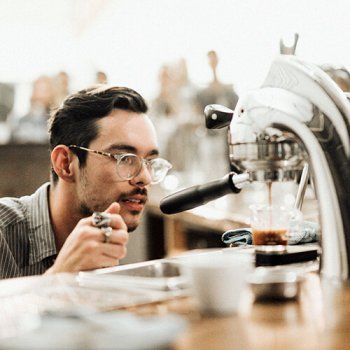 Engineer servicing commercial coffee machines