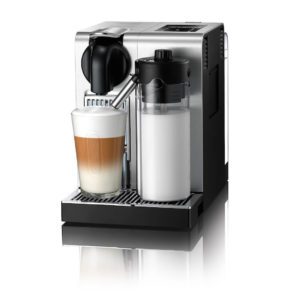 Nespresso Lattissima domestic pod coffee machine front view with cup of coffee in situ